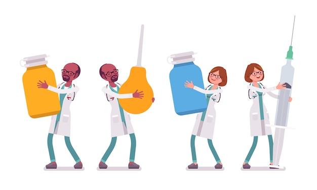 Mężczyzna I Kobieta Lekarz Z Gigantycznymi Narzędziami Premium Wektorów