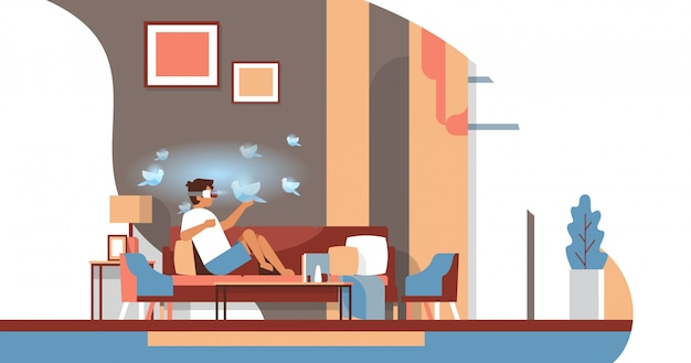 Mężczyzna nosić okulary cyfrowe dotykać rzeczywistości wirtualnej latające ptaki vr wizja słuchawki innowacja koncepcja salon wnętrze płaskie poziome Premium Wektorów