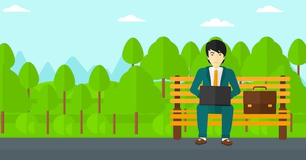 Mężczyzna pracuje na laptopie Premium Wektorów