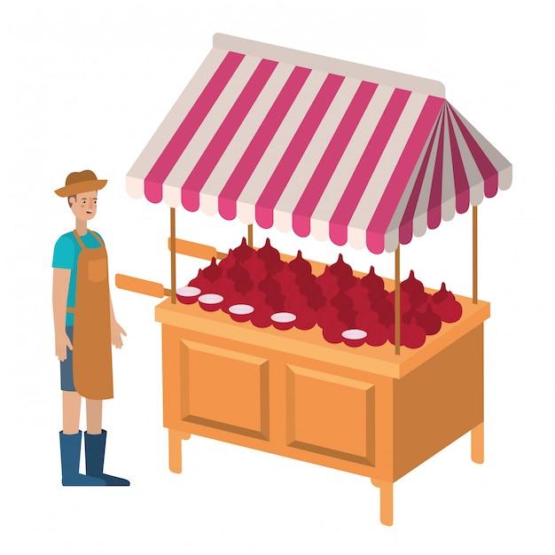 Mężczyzna Sprzedawca Warzyw Z Ikona Na Białym Tle Kiosku Premium Wektorów