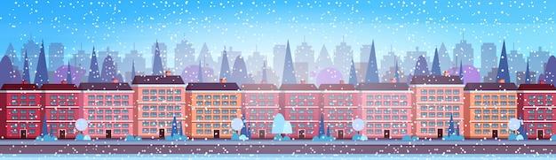 Miasto budynek domy zima ulica gród tło wesołych świąt szczęśliwego nowego roku Premium Wektorów