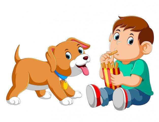 Młoda chłopiec je frytki z psem Premium Wektorów