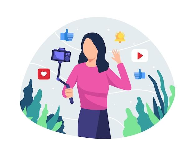 Młoda Kobieta Blogger Lub Vlongger Patrząc Na Kamery I Rozmawiając Na Kręcenie Wideo W Stylu Płaski Premium Wektorów