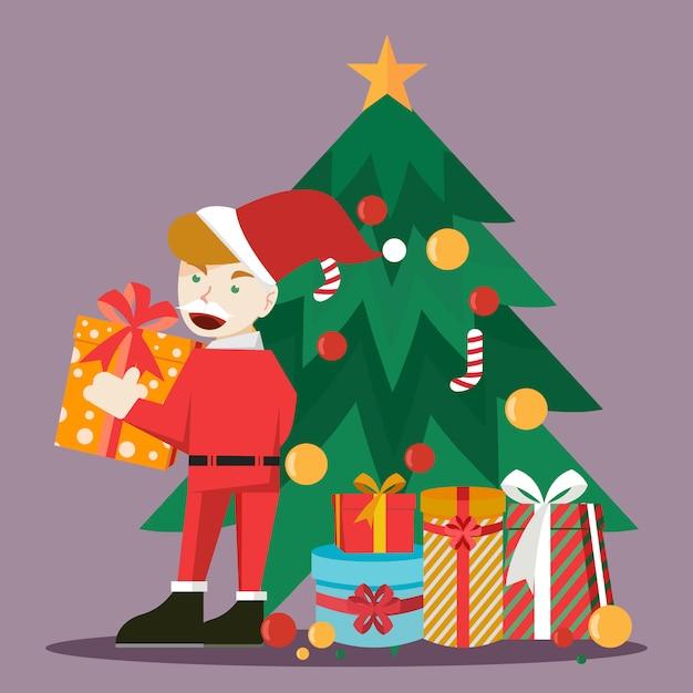 Młoda śnięty mikołaj trzyma prezent i stoi obok choinki Premium Wektorów