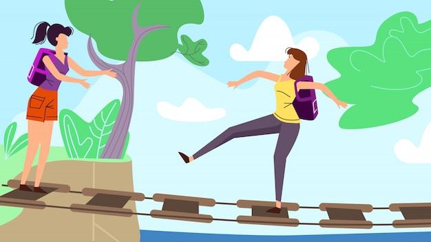 Młode kobiety chodzi wzdłuż zataczającego się mostu wiszącego w lesie lub parku. Premium Wektorów