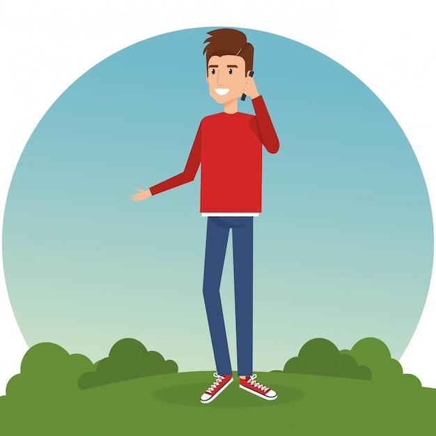 Młody człowiek dzwoni w parku Darmowych Wektorów