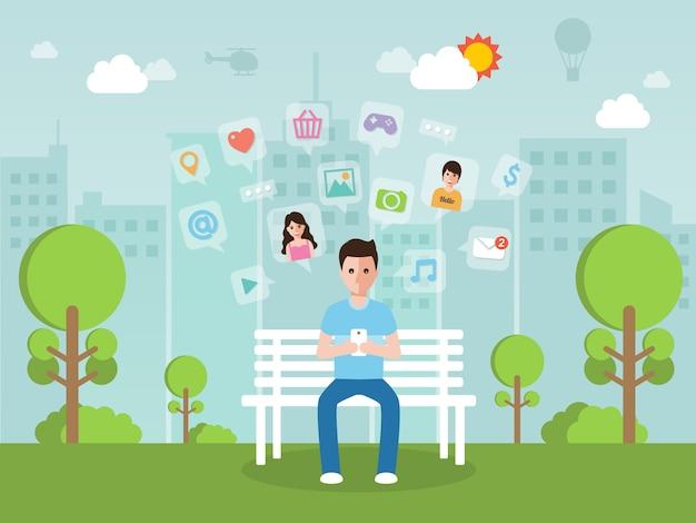 Młody człowiek rozmawia online na sieci społecznej z smartphone. Premium Wektorów