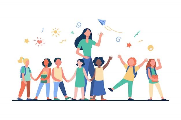 Młody Nauczyciel Z Radosnymi Dziećmi Darmowych Wektorów