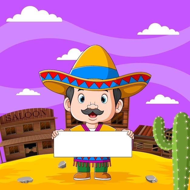 Na Ilustracji Meksykański Chłopiec Trzyma Pustą Tablicę Z Widokiem Na Pustynię Premium Wektorów