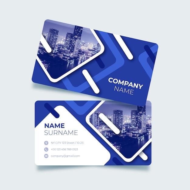 Niebieska wizytówka z abstrakcyjnymi kształtami Darmowych Wektorów