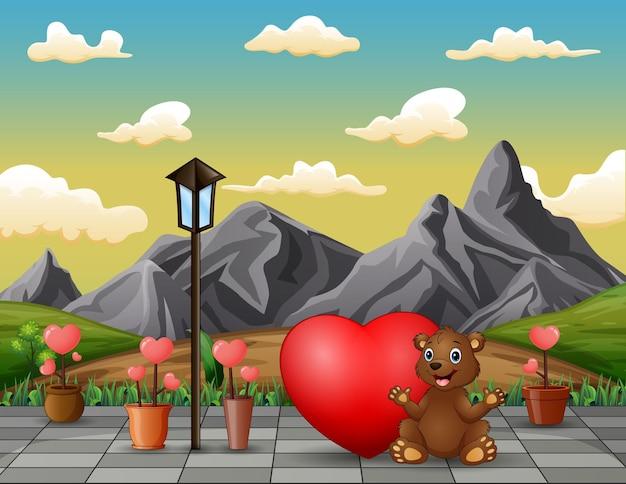 Niedźwiedź Siedzący Z Czerwonym Sercem W Krajobrazie Parku Premium Wektorów