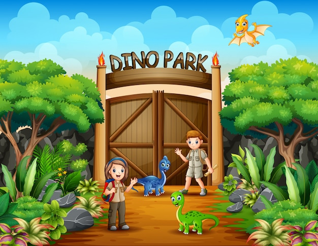Odkrywca Chłopiec I Dziewczynka W Parku Dino Premium Wektorów