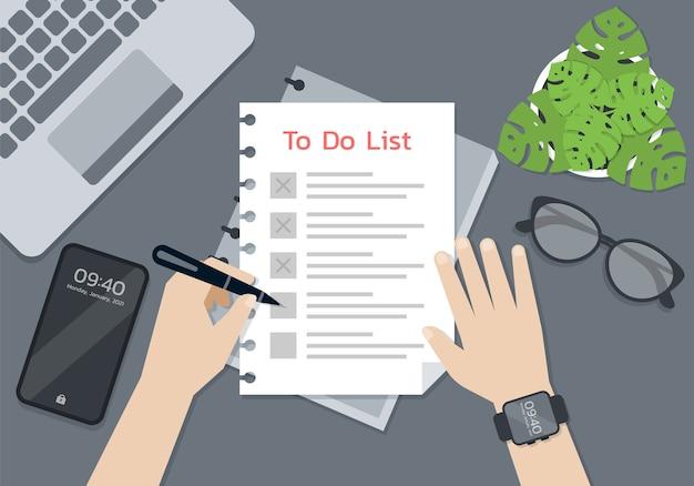Osoba Trzymając Się Za Ręce Pióro I Pisać Na Papierze Listy Rzeczy Do Zrobienia, Koncepcja Inteligentnego życia Premium Wektorów