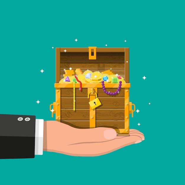 Otwarta Skrzynia Pełna Skarbów W Ręku Premium Wektorów