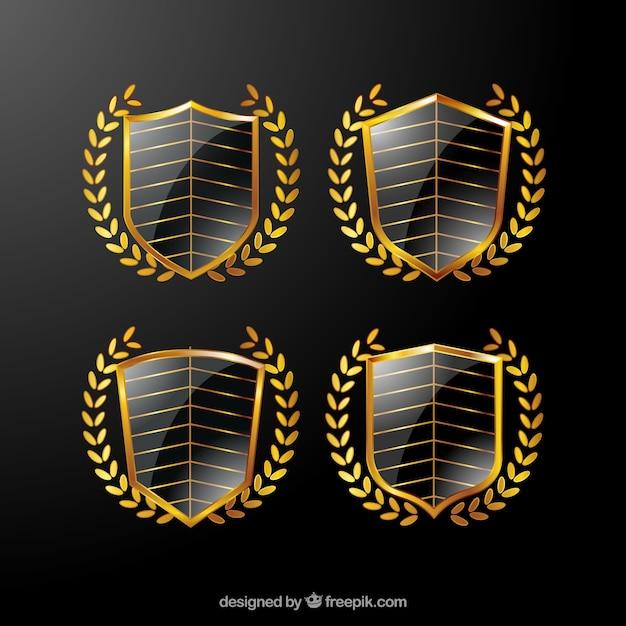 Paczka cztery złote tarcze ozdobnych Darmowych Wektorów