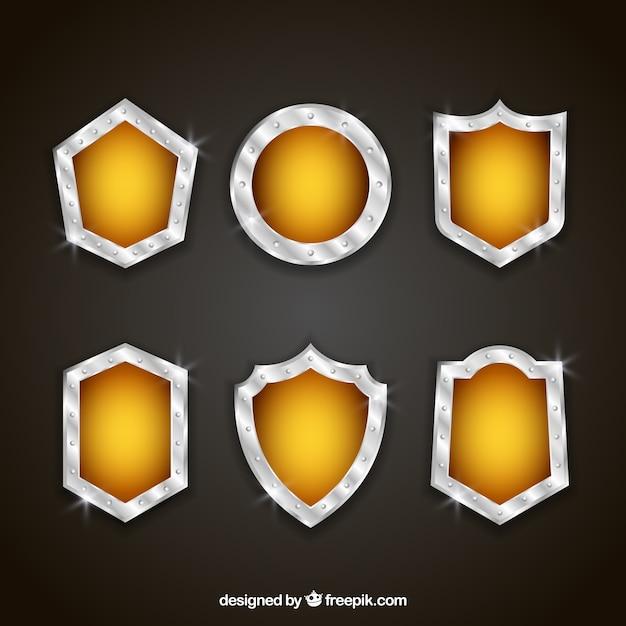 Paczka z tarczami metalowymi i żółte Darmowych Wektorów