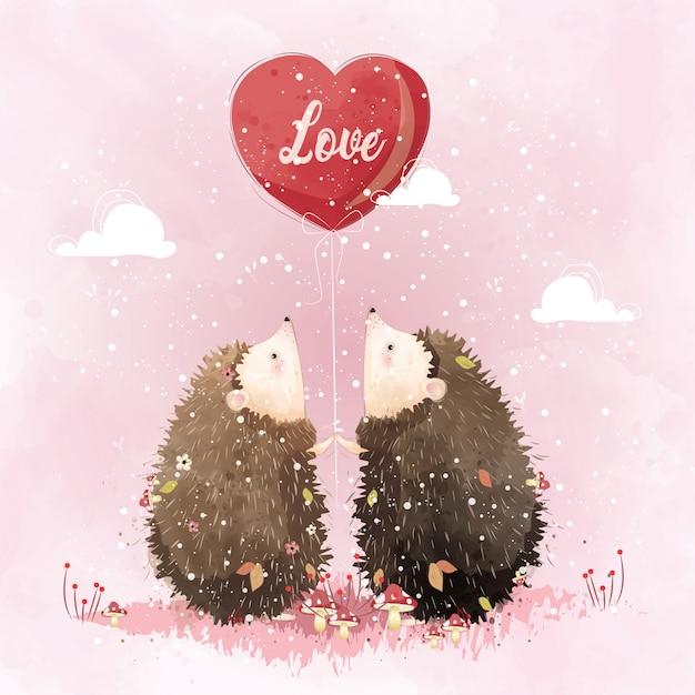 Para jeż trzyma balon miłości Premium Wektorów