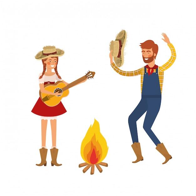 Para rolników taniec z słomkowym kapeluszem i ogniskiem Premium Wektorów