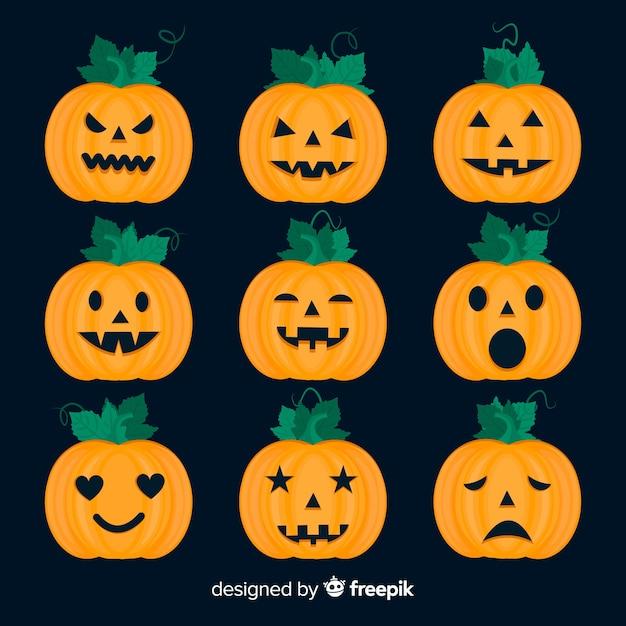 Płaska kolekcja dyni halloween na czarnym tle Darmowych Wektorów