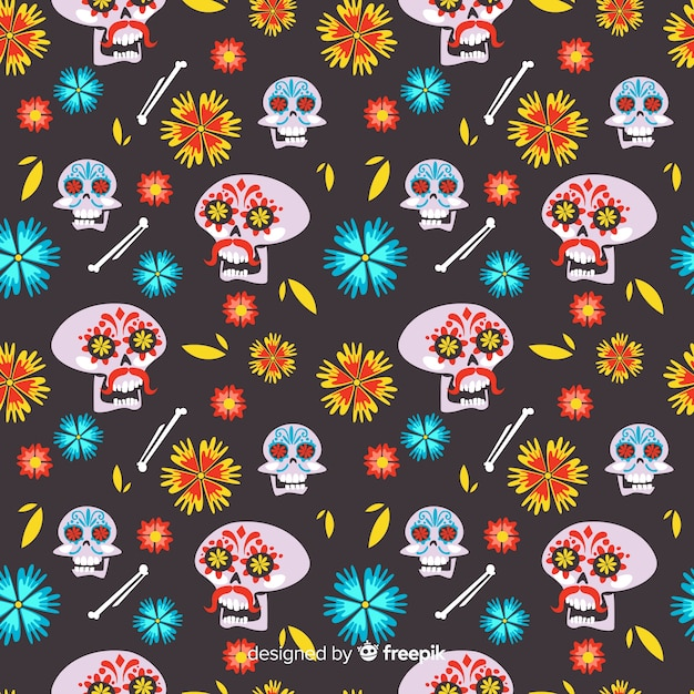 Płaski wzór día de muertos z kwiatowymi czaszkami Darmowych Wektorów