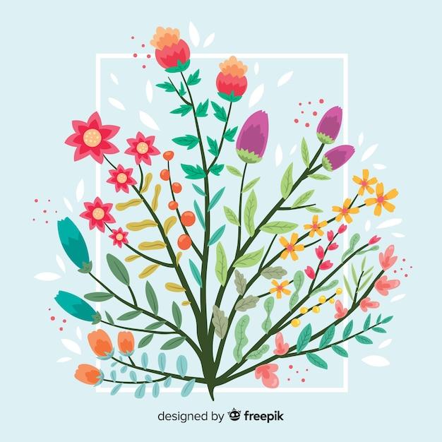 Płaskie Kolorowe Oddział Kwiatowy Na Niebieskim Tle Darmowych Wektorów