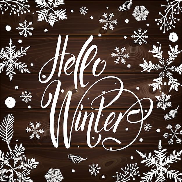 Pocztówka Hello Winter Z Uroczymi Płatkami śniegu Premium Wektorów