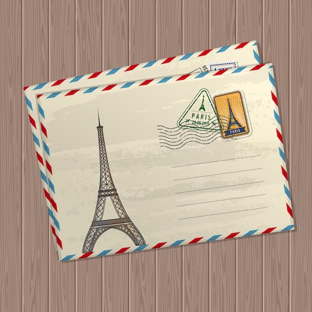 Pocztówka w stylu vintage z wieżą eiffla, znakami i znaczkami francji Premium Wektorów