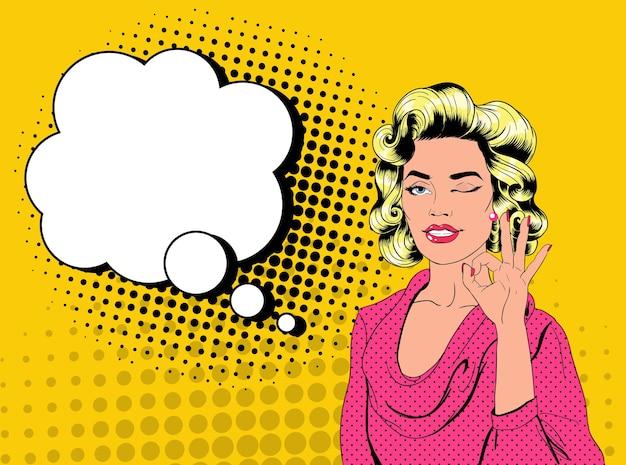 Pop Art Dość Blond Kobieta Mrugając I Pokazując Znak Ok. Radosna Dziewczyna Vintage Plakat Z Komiksową Dymek. Przypnij Baner Reklamowy Na Afisz. Premium Wektorów