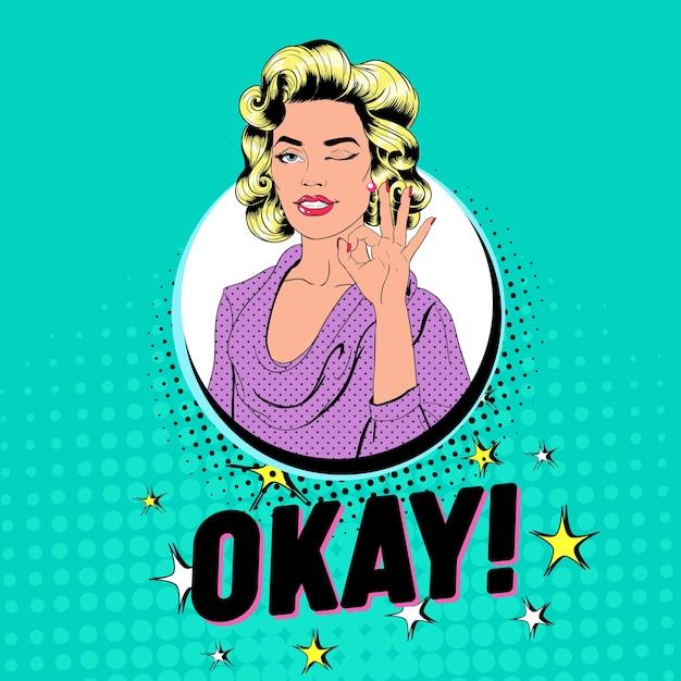 Pop Art Piękna Kobieta Mrugając I Pokazując Znak Ok. Radosna Dziewczyna Vintage Plakat Z Komiksową Dymek. Przypnij Baner Reklamowy Na Afisz. Premium Wektorów