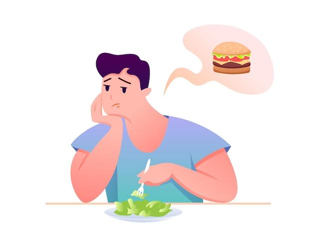 Postać Z Kreskówki Siedzi Przy Stole, Zdrowe Odżywianie, Marzy O Niezdrowym Burgerze Premium Wektorów