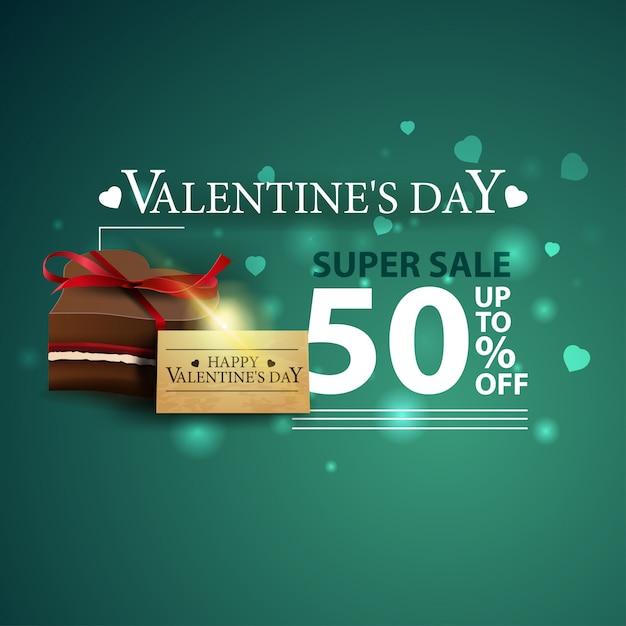 Rabat zielony baner na walentynki z cukierków czekoladowych Premium Wektorów