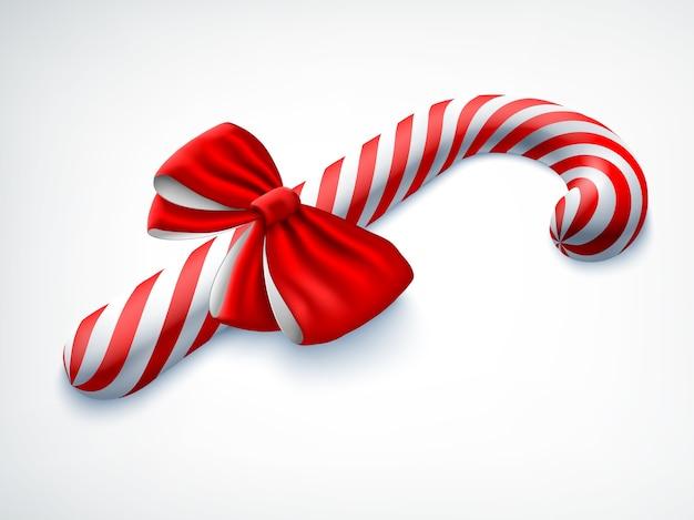 Realistyczna Cukierkowa Laska Ozdobiona Czerwoną Kokardką Na Białym Tle Darmowych Wektorów