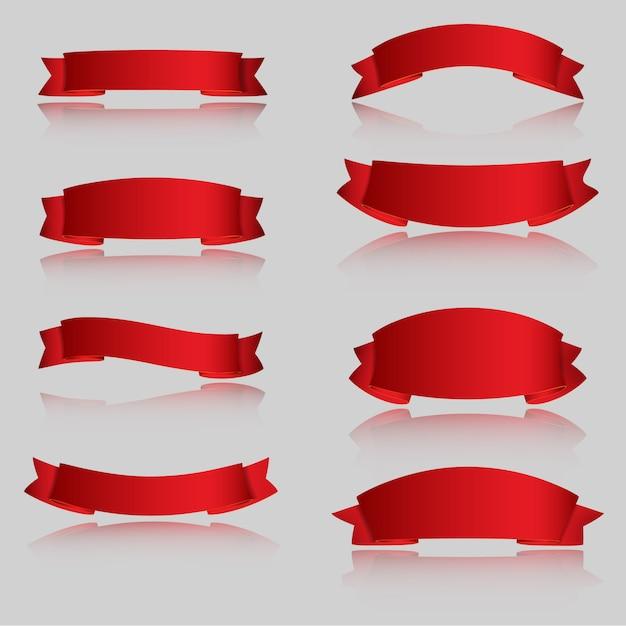 Realistyczne czerwone błyszczące wstążki wektorowe Premium Wektorów