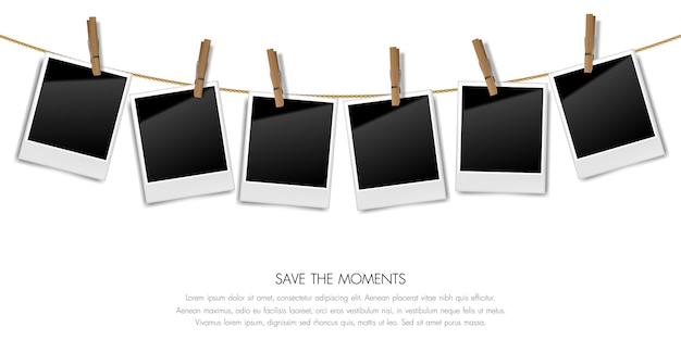 Realistyczne puste retro fotografii ramy na arkanie z drewnianymi klamerkami, wektorowa ilustracja Premium Wektorów
