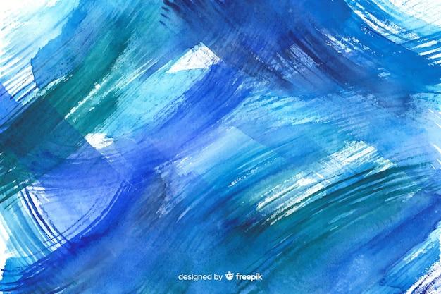Ręcznie malowane kolorowe tło akwarela Darmowych Wektorów