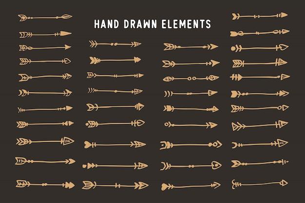 Ręcznie rysowane etniczne strzałki stylu boho Premium Wektorów