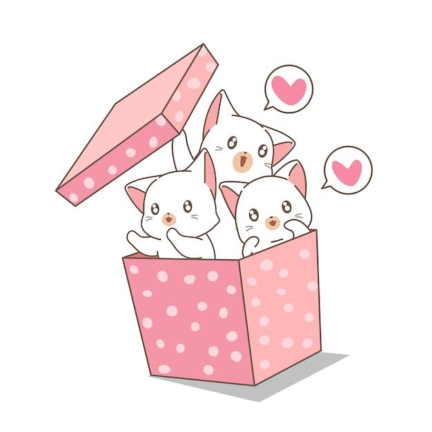 Ręcznie Rysowane Kawaii Koty W Różowym Pudełku Premium Wektorów