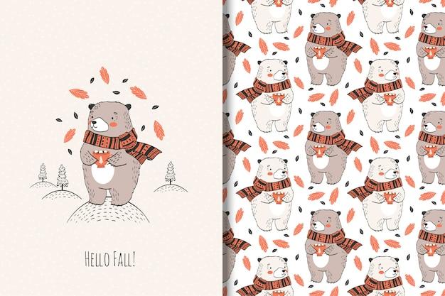Ręcznie rysowane słodki miś z kubkiem. ilustracja zwierząt jesienią. Premium Wektorów