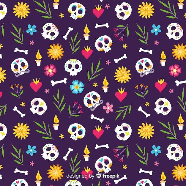 Ręcznie rysowane wzór obracanych czaszek día de muertos Darmowych Wektorów