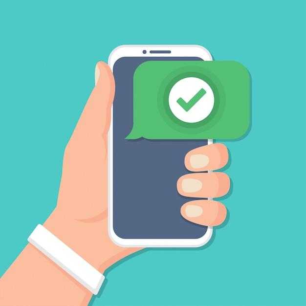 Ręka Trzyma Smartfon Z Ikoną Wyboru W Płaskiej Konstrukcji Premium Wektorów