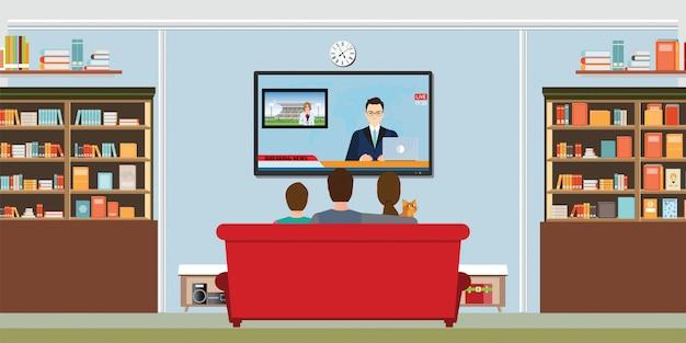 Rodzina ogląda codzienne wiadomości telewizyjne Premium Wektorów