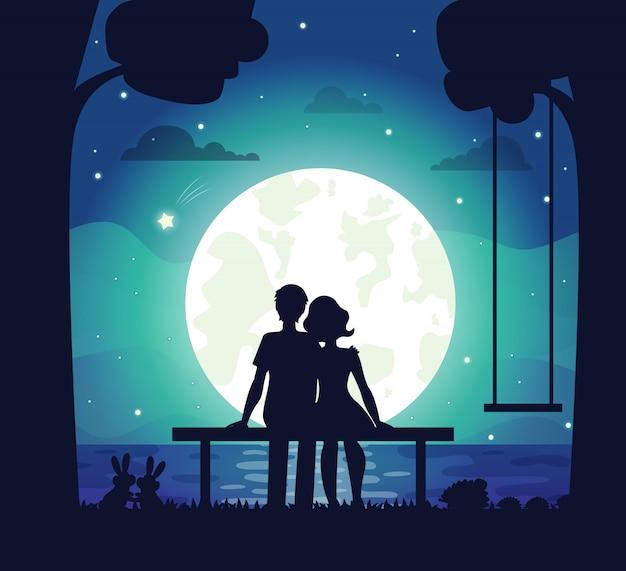 Romantyczna para siedzi nad morzem w świetle księżyca Premium Wektorów