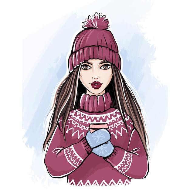 Romantyczna zimowa dziewczyna w swetrze i czapce z dzianiny, ciesząca się filiżanką kawy Premium Wektorów