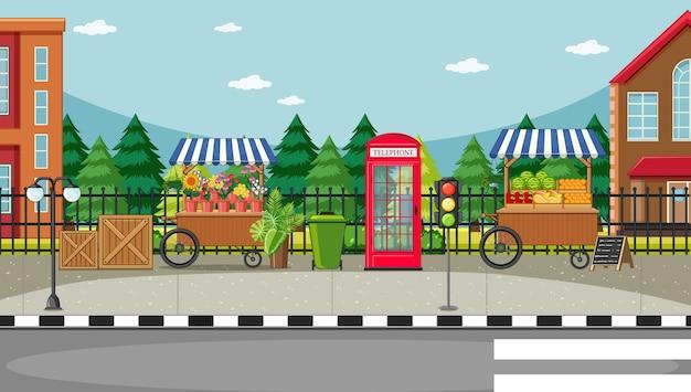 Scena Od Strony Ulicy Z Wózkiem Na Kwiaty I Wózkiem Z Owocami Premium Wektorów