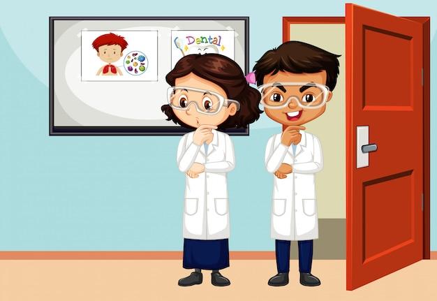 Scena W Klasie Z Dwoma Studentami Nauk ścisłych W środku Premium Wektorów
