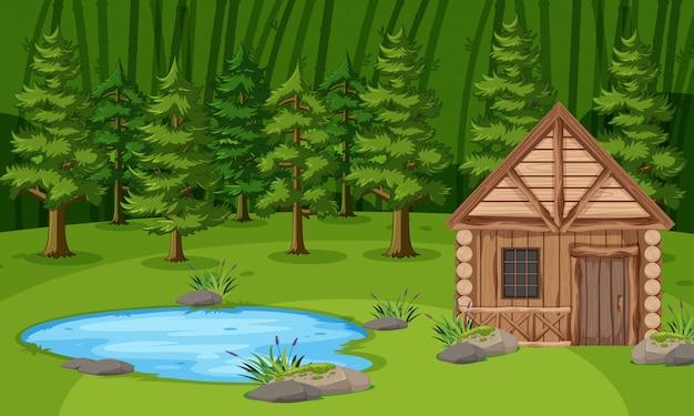 Scena Z Drewnianą Chatą Nad Stawem W Zielonym Lesie Premium Wektorów