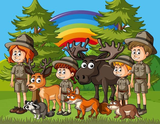 Scena Ze Strażnikami I Wieloma Dzikimi Zwierzętami W Parku Premium Wektorów