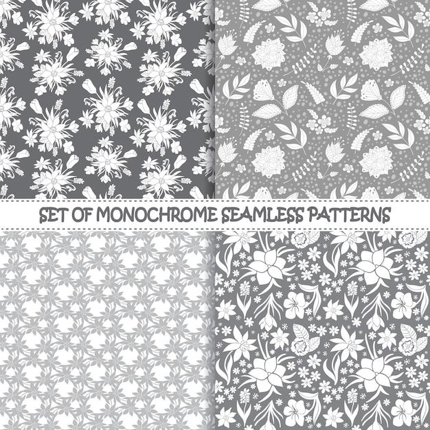 Set bezszwowi monochromatyczni wektorowi wzory. kwieciści wzory. monochromatyczne bezszwowe wektor wzorców. Premium Wektorów