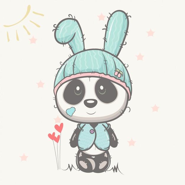 Śliczna dziecko panda z królika kapeluszem Premium Wektorów