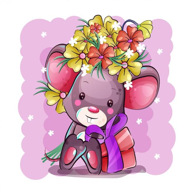 Śliczna kreskówkowa mysz z kwiatami i prezentem Premium Wektorów
